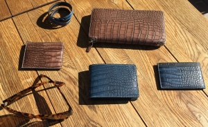 A Collection of Bianca Mosca Custom Wallets and Bracelet